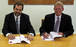 Antonio Campos and Geoff Inskip sign the contract for the new Midland Metro trams.