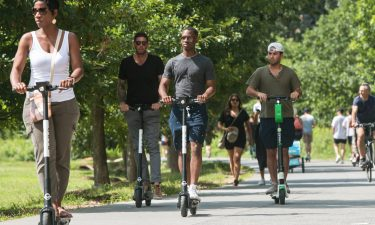 People riding e-scooters through Atlanta