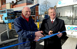 Cllr Lindsley Harvard, left, and Cllr John McNicholas cut the ribbon to open the second access at Coventry's Pool Meadow bus station.