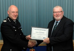 Commander Adrian Hanstock awards Mike Rumens (right) from Arriva