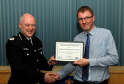 Commander Adrian Hanstock awards Sean Sumner (right) from Arriva