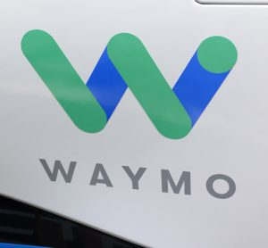 Waymo logo on the side of an autonomous car