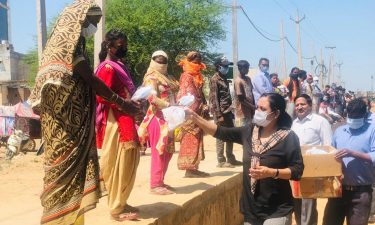 handing out food at slum
